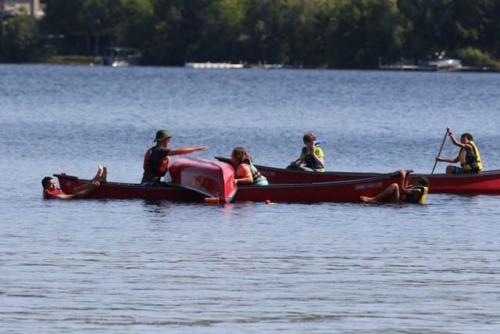 Canoes on lake lovering.png